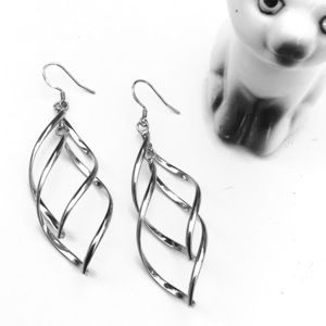 Beautiful swirly silver drop earrings